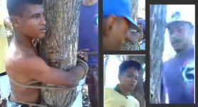 A vítima foi amarrada a uma árvore. Nos destaques, o rosto dos agressores que aparecem no vídeo.